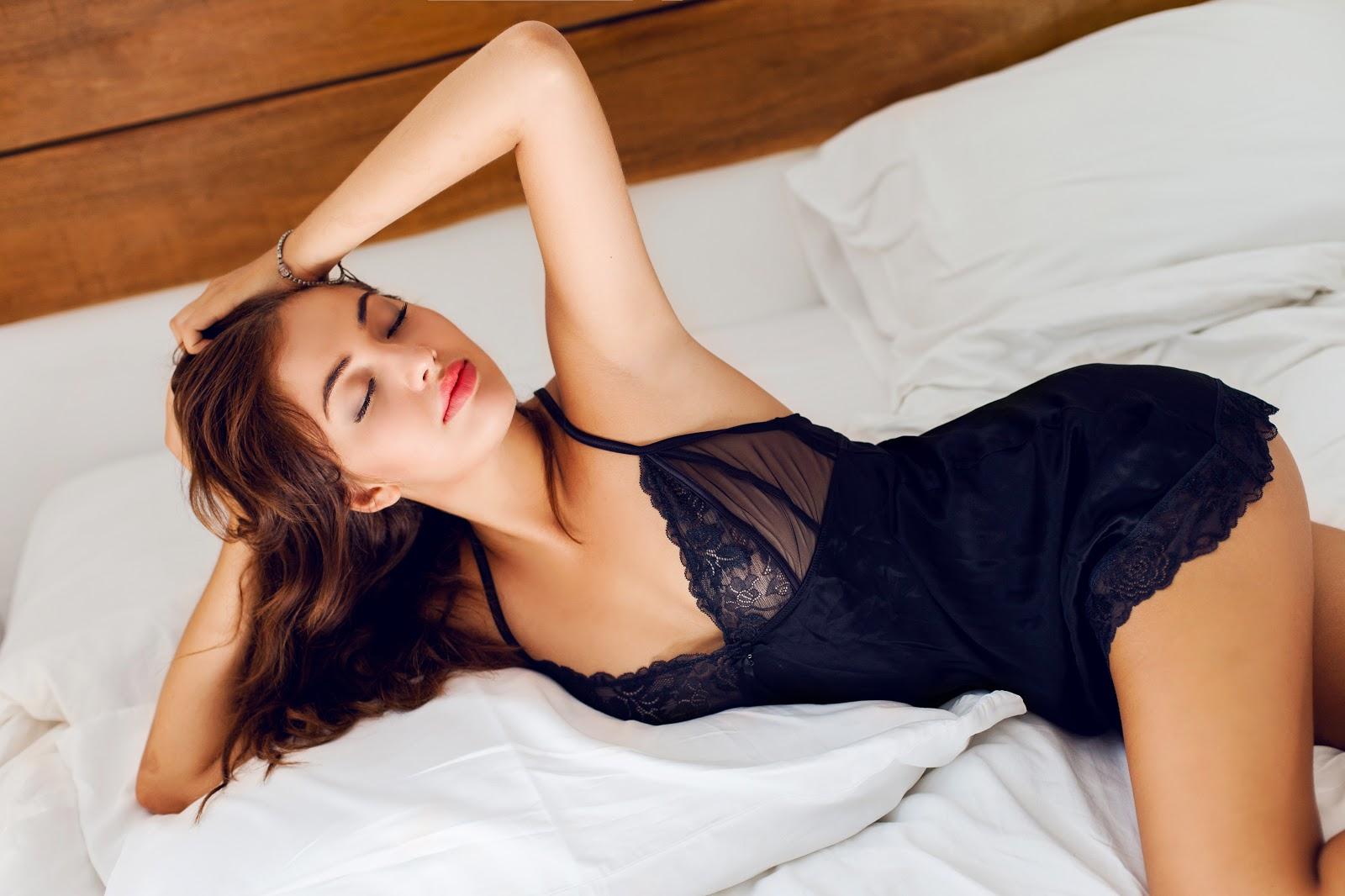 Ukrainian sexy tanned fit woman in luxury silk lingerie
